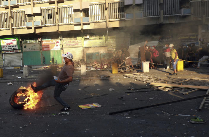 Anti-government protesters set fire and close streets during ongoing protests in Baghdad, Iraq, in central Baghdad, Iraq, Saturday, Nov. 9, 2019. Iraqi security forces killed several anti-government protesters and wounded others on Saturday, pushing them back from three flashpoint bridges in central Baghdad, medical and security officials said. (AP Photo/Hadi Mizban)