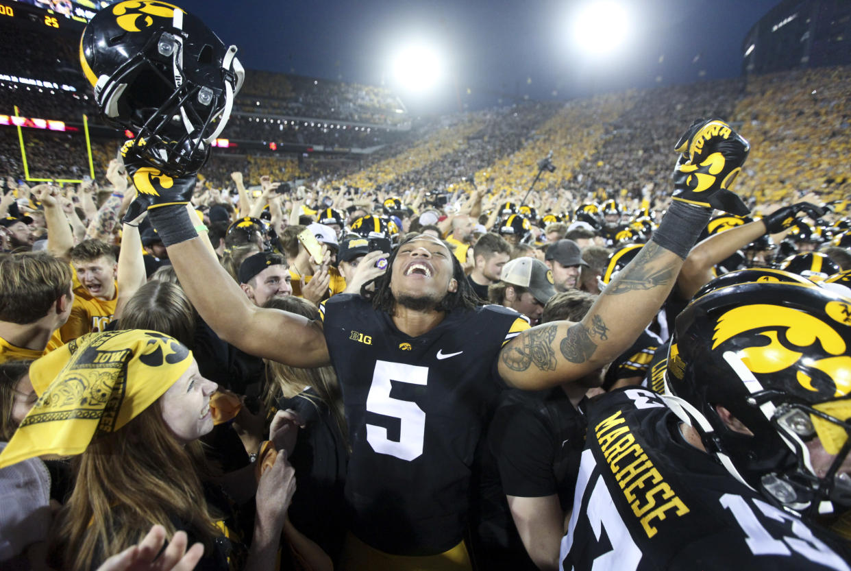 IOWA CITY, IOWA- OCTOBER 9:  Linebacker Jestin Jacobs #5 of the Iowa Hawkeyes celebrates with fans after the match-up against the Penn State Nittany Lions at Kinnick Stadium on October 9, 2021 in Iowa City, Iowa.  (Photo by Matthew Holst/Getty Images)