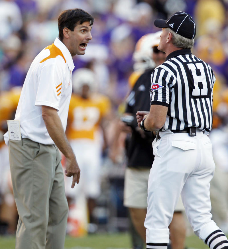 Tennessee head coach Derek Dooley reacts after Tennessee was penalized on the final play of the game, allowing LSU to run one more play and score a touchdown to win, during an NCAA football game in Baton Rouge, Saturday, Oct. 2, 2010. LSU won 16-14. (AP Photo/Gerald Herbert)