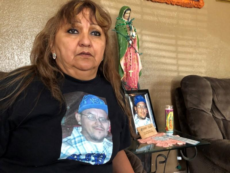 Erma Aldaba sits in her home, wearing a T-shirt emblazoned with the image of her son Johnny Leija, who died in hospital after a deadly encounter with the police, in Madill, Oklahoma