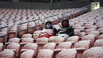 Real Salt Lake fans watch in the second half of an MLS soccer match against Sporting Kansas City, Sunday, Nov. 8, 2020, in Sandy, Utah. (AP Photo/Rick Bowmer)