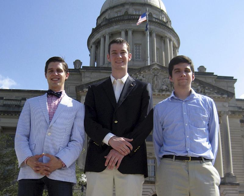 """In this May 24, 2012, photo, John Ramsey, center, accompanied by Preston Bates left, and Doug Lusco, right, young Republicans involved in the Liberty For All political group, stand in front of the state Capitol in Frankfort, Ky. John Ramsey stands out in a new campaign finance world order filled with big names like Republican casino mogul Sheldon Adelson and Democratic Hollywood producer Jeffrey Katzenberg. The little-known senior at Stephen F. Austin University.is the founder of a team of college-aged Republicans that liberals have dubbed the """"Brat PAC,"""" which helped propel one congressional candidate to victory and intends to get involved in other House races. And he's just the latest wealthy individual to try to influence federal elections in the wake of a series of federal court decisions that deregulated the campaign finance system and dramatically changed the country's political landscape.  (AP Photo/Roger Alford)"""