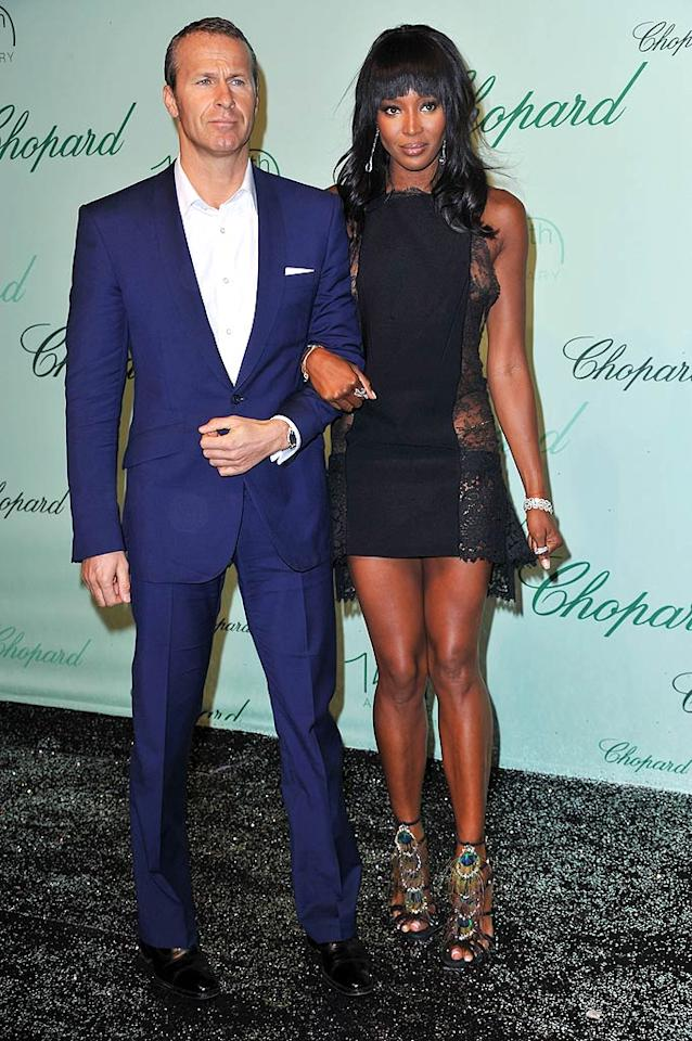 "Supermodel Naomi Campbell showed off her toned gams and her hot beau, Vladimir Doronin. It's a tough call, but which of them do you think is dressed better? Pascal Le Segretain/<a href=""http://www.gettyimages.com/"" target=""new"">GettyImages.com</a> - May 17, 2010"