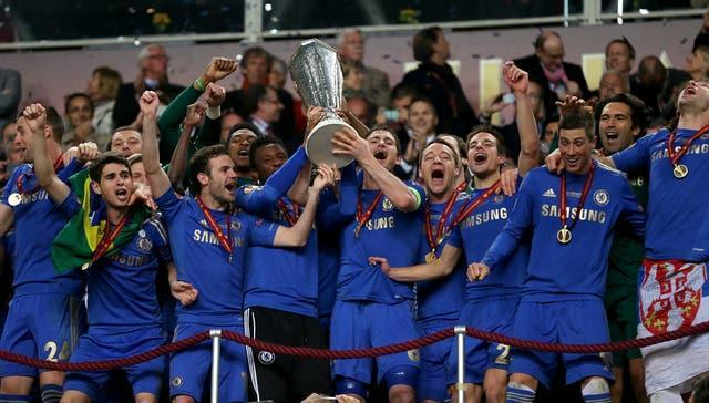 Chelsea players celebrate with the Europa League trophy