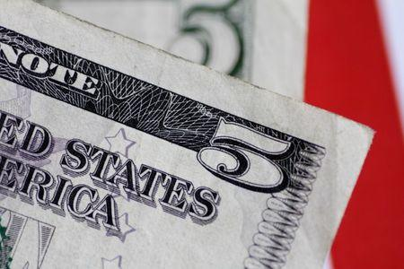 Dollar slips lower before Fed rate decision