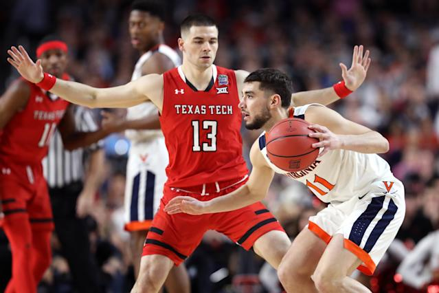 Ty Jerome #11 of the Virginia Cavaliers is defended by Matt Mooney #13 of the Texas Tech Red Raiders in the first half during the 2019 NCAA men's Final Four National Championship game at U.S. Bank Stadium on April 08, 2019 in Minneapolis, Minnesota. (Photo by Streeter Lecka/Getty Images)