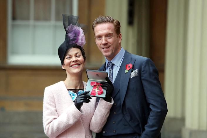 Image: English actress Helen McCrory with her husband Damian Lewis after she was awarded an Officer of the Most Excellent Order of the British Empire (OBE) for services to drama (Steve Parsons / AFP - Getty Images file)