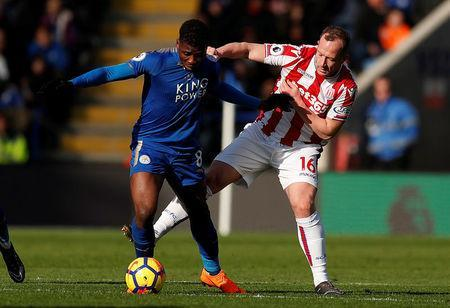 Soccer Football - Premier League - Leicester City vs Stoke City - King Power Stadium, Leicester, Britain - February 24, 2018 Leicester City's Kelechi Iheanacho in action with Stoke City's Charlie Adam Action Images via Reuters/Andrew Boyers