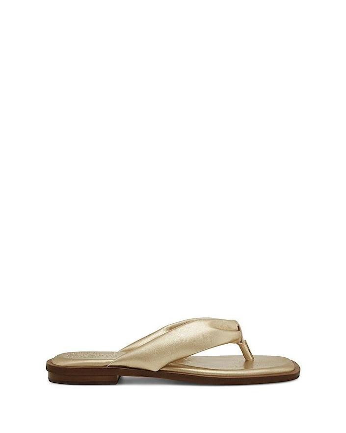 """<p><strong>Vince Camuto</strong></p><p>vincecamuto.com</p><p><strong>$69.00</strong></p><p><a href=""""https://go.redirectingat.com?id=74968X1596630&url=https%3A%2F%2Fwww.vincecamuto.com%2Fen%2Fus%2Fproduct%2Fvince-camuto-norshie-thong-sandal%2F8200000000507929&sref=https%3A%2F%2Fwww.goodhousekeeping.com%2Fclothing%2Fg30633786%2Fspring-shoes-trends%2F"""" rel=""""nofollow noopener"""" target=""""_blank"""" data-ylk=""""slk:Shop Now"""" class=""""link rapid-noclick-resp"""">Shop Now</a></p><p>Elevate your traditional thong</p>"""