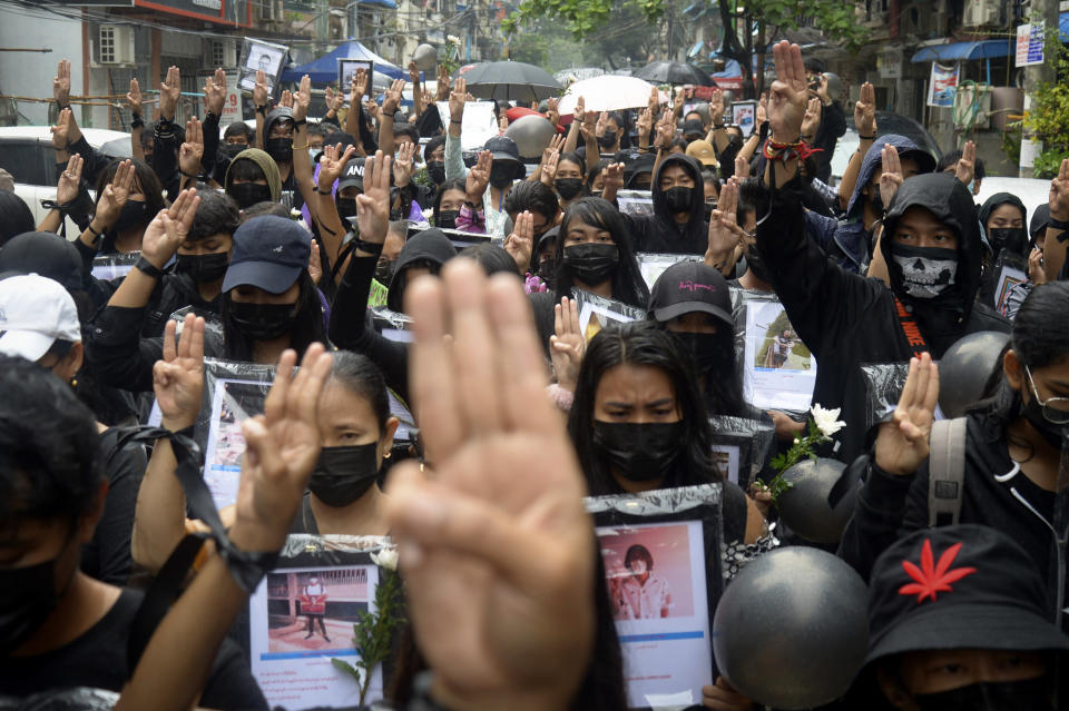 Anti-coup protesters flash three-fingered symbol of resistance as they gather to pray for those who died during a protest against the military in Yangon, Myanmar, Monday, April 5, 2021. Threats of lethal violence and arrests of protesters have failed to suppress daily demonstrations across Myanmar demanding the military step down and reinstate the democratically elected government. (AP Photo)