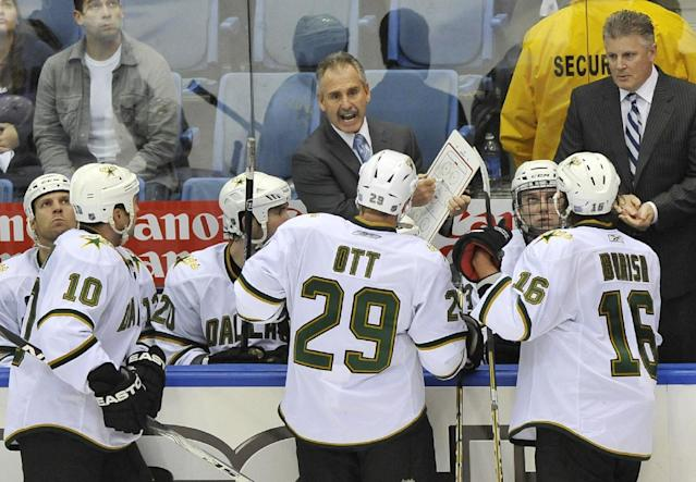Dallas Stars Assistant Coach Willie Desjardins talks to players as Head Coach Marc Crawford listens at right during an NHL hockey game against the New York Islanders Saturday, Oct. 9, 2010, in Uniondale, New York. (AP Photo/Kathy Kmonicek)