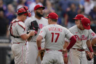 Philadelphia Phillies relief pitcher Jose Alvarado, second from left, reacts after New York Mets' Francisco Lindor hit an RBI-single during the seventh inning of the first baseball game of a doubleheader Friday, June 25, 2021, in New York. (AP Photo/Frank Franklin II)