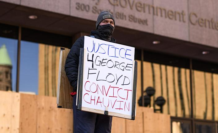 Image: People gather for a press conference outside the Hennepin County Government Center (Stephen Maturen / Getty Images file)