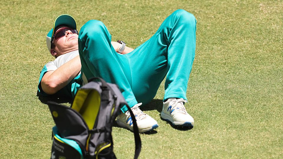 Steve Smith can be seen stretching his back out before the Adelaide Test.