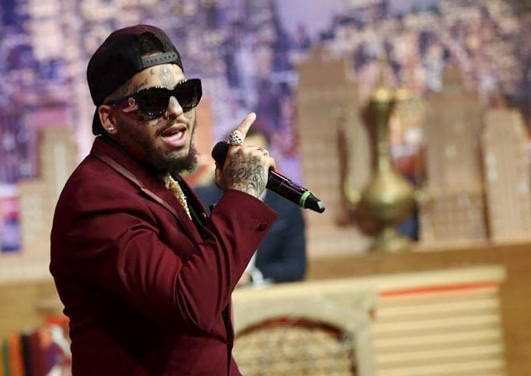 Swagg Man singing during a television show in the Tunisian capital Tunis in May 2019