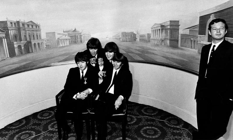 Brian Epstein with the Beatles in 1965 when they received MBEs at Buckingham Palace
