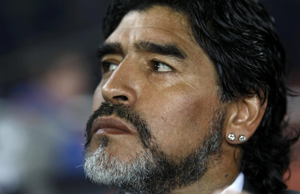 Argentina's head coach Diego Maradona sits on the bench during a 2010 World Cup Group B soccer match against Greece at Peter Mokaba stadium in Polokwane June 22, 2010.       REUTERS/Eddie Keogh (SOUTH AFRICA  - Tags: SPORT SOCCER WORLD CUP)