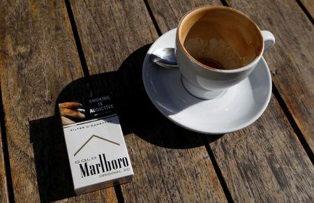 FILE PHOTO: A Marlboro cigarettes pack, a brand of Philip Morris Tobacco, lies next to an empty coffee cup at a cafe in central Sydney