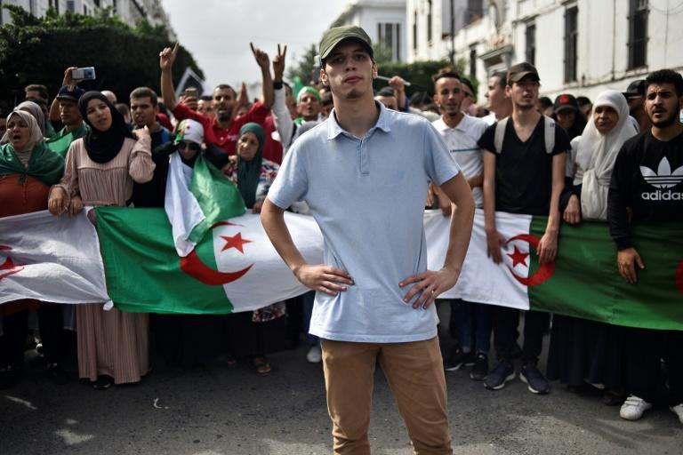 Many young Algerians say faced with unpopular candidates in the presidential election, abstention will be their only choice (AFP Photo/RYAD KRAMDI)