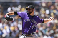 Colorado Rockies starting pitcher Austin Gomber winds up against the San Diego Padres in the first inning of a baseball game Sunday, Aug. 1, 2021, in San Diego. (AP Photo/Derrick Tuskan)