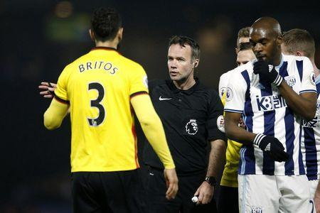 Britain Football Soccer - Watford v West Bromwich Albion - Premier League - Vicarage Road - 4/4/17 Watford's Miguel Britos is sent off by referee Paul Tierney Action Images via Reuters / Andrew Couldridge Livepic