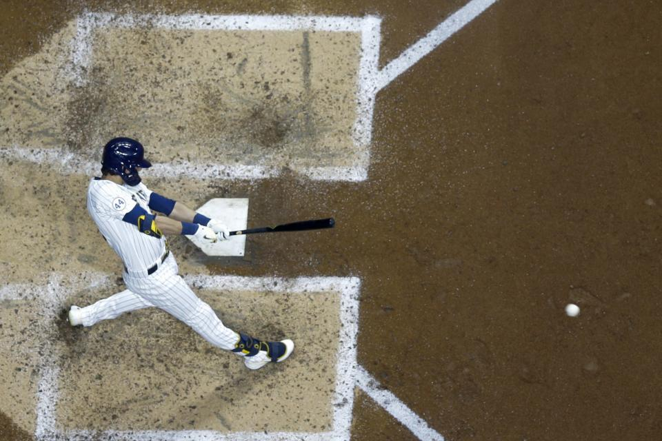 Milwaukee Brewers' Christian Yelich hits a double during the fifth inning of a baseball game against the Chicago Cubs Saturday, Sept. 18, 2021, in Milwaukee. (AP Photo/Morry Gash)