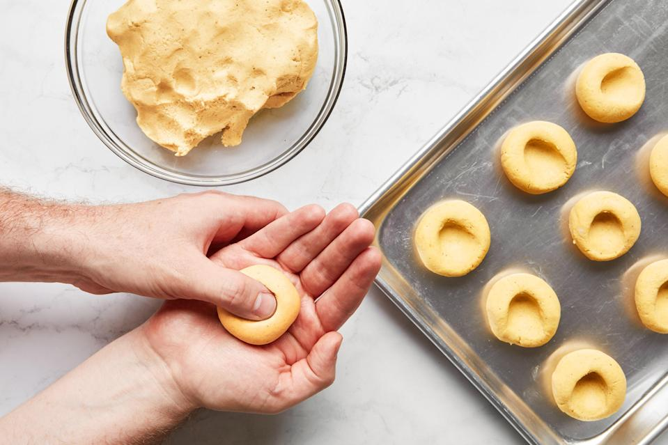Forming masa into chochoyotes, dimpled dumplings that taste like clouds of toasted corn.