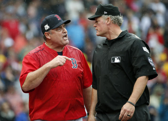 Boston Red Sox manager John Farrell, left, argues his point to crew chief umpire Ted Barrett after he was ejected during the second inning in Game 4 of baseball's American League Division Series against the Houston Astros, Monday, Oct. 9, 2017, in Boston. (AP)