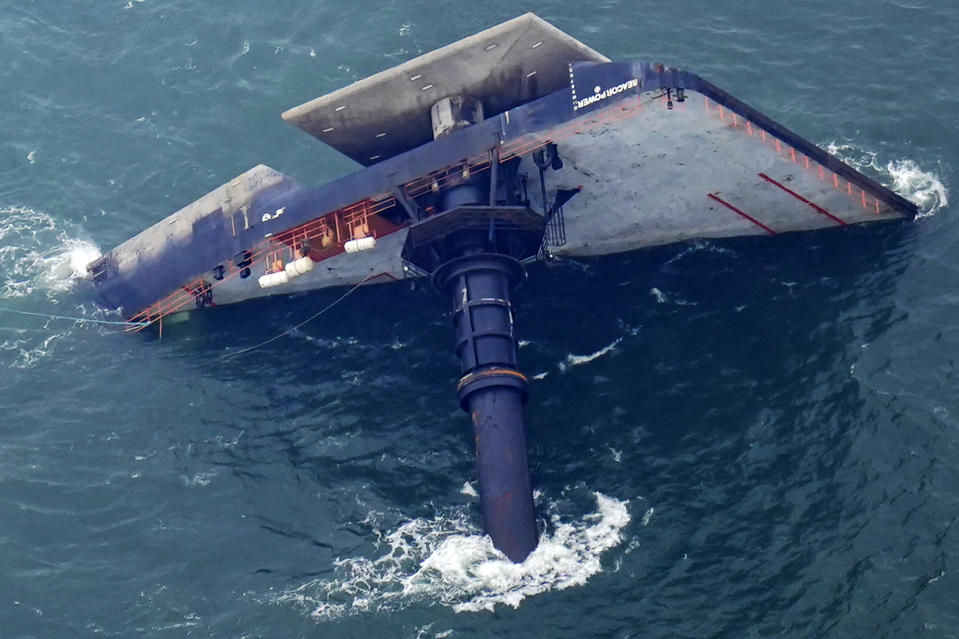 The capsized lift boat Seacor Power is seen seven miles off the coast of Louisiana in the Gulf of Mexico Sunday, April 18, 2021. The vessel capsized during a storm on Tuesday. (AP Photo/Gerald Herbert)
