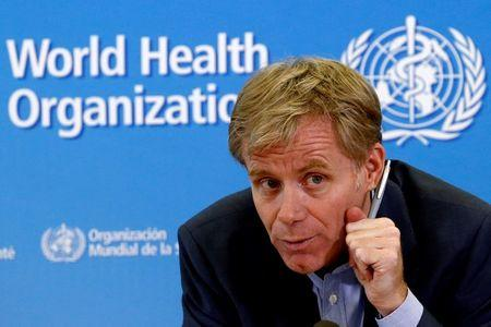 WHO Assistant Director General Aylward gestures during a news conference at the organization's headquarters in Geneva