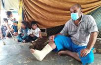 Abu Alaa, a 43-year-old farmer and a Syrian refugee from Homs, sits in a tent at an informal tented settlement in Akkar