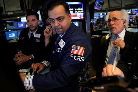 Traders work on the floor at the New York Stock Exchange in Manhattan New York