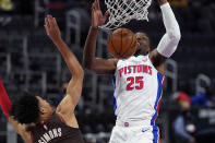 Detroit Pistons forward Tyler Cook (25) dunks as Portland Trail Blazers guard Anfernee Simons defends during the second half of an NBA basketball game, Wednesday, March 31, 2021, in Detroit. (AP Photo/Carlos Osorio)