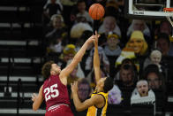 Indiana forward Race Thompson (25) is fouled by Iowa forward Keegan Murray during the second half of an NCAA college basketball game, Thursday, Jan. 21, 2021, in Iowa City, Iowa. Indiana won 81-69. (AP Photo/Charlie Neibergall)