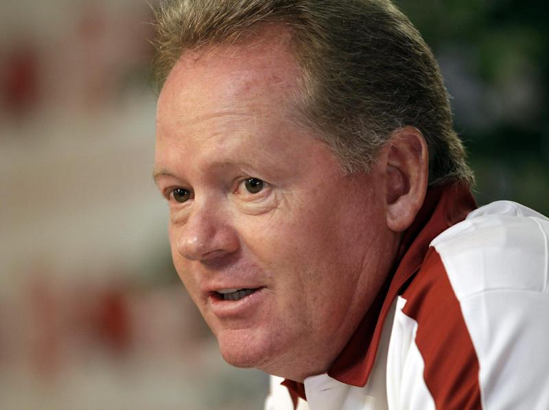 FILE - In this file photo taken Aug. 6, 2011, then Arkansas NCAA college football coach Bobby Petrino discusses the Razorbacks prospects during a news conference in Fayetteville, Ark. Western Kentucky has hired Petrino as its new football coach, said a person familiar with the decision. The person said the former Arkansas coach is expected to be introduced at a Monday, Dec. 10, 2012, news conference. The person spoke to The Associated Press on condition of anonymity because the school has not officially announced Petrino's hiring. (AP Photo/Danny Johnston, file)