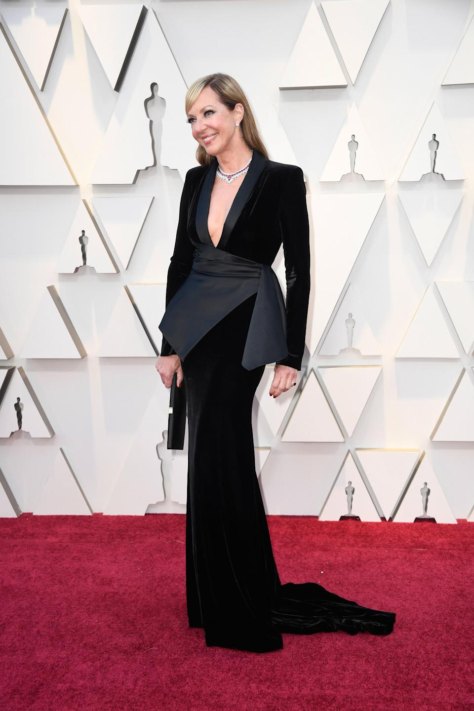 Allison Janney in Pamella Roland and Chopard jewelry with a Roger Vivier bag
