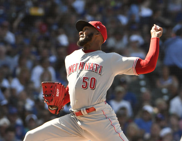 Cincinnati Reds relief pitcher Amir Garrett (50) throws against the Chicago Cubs during the seventh inning of a baseball game Saturday, July 7, 2018, in Chicago. (AP Photo/David Banks)