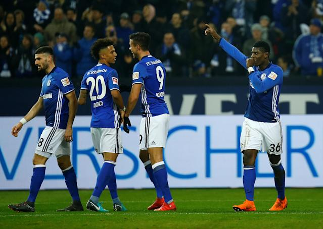 Soccer Football - Bundesliga - Schalke 04 vs TSG 1899 Hoffenheim - Veltins-Arena, Gelsenkirchen, Germany - February 17, 2018 Schalke's Breel Embolo celebrates with team mates after scoring their second goal REUTERS/Leon Kuegeler DFL RULES TO LIMIT THE ONLINE USAGE DURING MATCH TIME TO 15 PICTURES PER GAME. IMAGE SEQUENCES TO SIMULATE VIDEO IS NOT ALLOWED AT ANY TIME. FOR FURTHER QUERIES PLEASE CONTACT DFL DIRECTLY AT + 49 69 650050