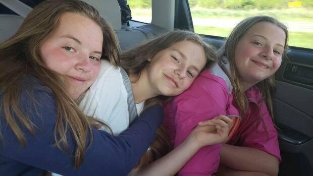 Lexi Daken, centre, with friend Darian Crouse, left, and Carly Crouse. (Submitted by Chris Daken - image credit)