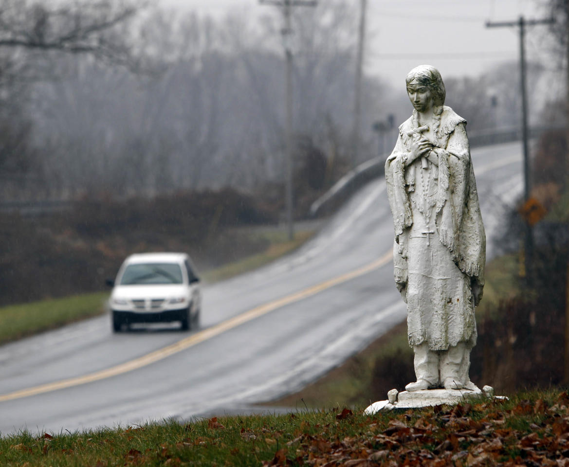 in a Wednesday, Dec. 21, 2011 photo, a statue of the Blessed Kateri Tekakwitha stands near the road at the National Kateri Shrine and Indian Museum in Fonda, N.Y. Tekakwitha, who will be canonized next year, was a Native American baptized in 1676 in the Mohawk Valley. She fled to a mission in Canada after being scorned and threatened in her home village near what is now the village of Fonda. (AP Photo/Mike Groll)