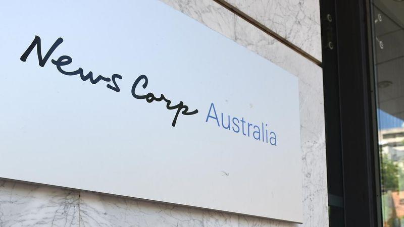 Images of News Corp logo as company ceases printing 100 papers, 500 jobs lost