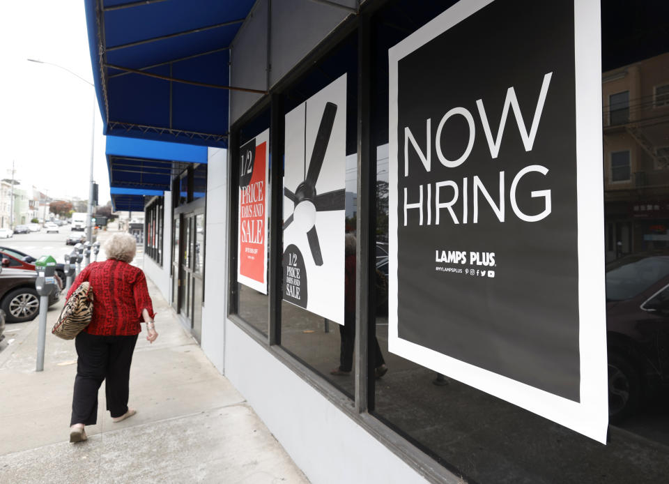 SAN FRANCISCO, CALIFORNIA - SEPTEMBER 16: A pedestrian walks by a now hiring sign at a Lamps Plus store on September 16, 2021 in San Francisco, California. Unemployment claims inched up to 332,000 from a pandemic low of 312,000 a week before. (Photo by Justin Sullivan/Getty Images)