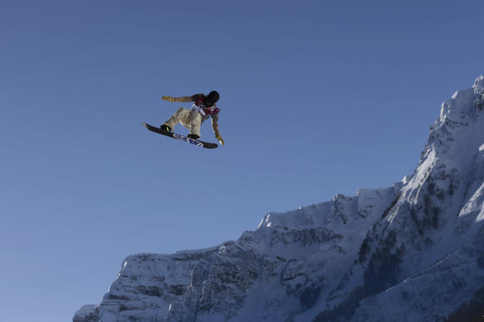 Sage Kotsenburg of the United States takes a jump during a Snowboard Slopestyle training session at the Rosa Khutor Extreme Park, prior to the 2014 Winter Olympics, Tuesday, Feb. 4, 2014, in Krasnaya Polyana, Russia. (AP Photo/Andy Wong)