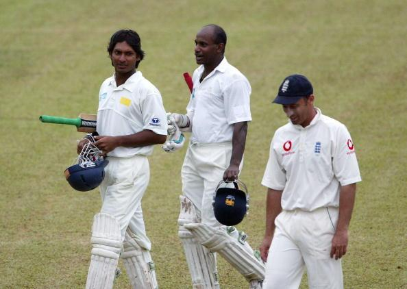 KANDY, SRI LANKA - DECEMBER 12:  Sri Lankan batsmen Kumar Sangakkara (L) and Sanath Jayasuriya leave the field with England fielder Nasser Hussain after bad light stopped play during the third day of the second test match between Sri Lanka and England  at Asgiriya Stadium on December 12, 2003 in Kandy, Sri Lanka. (Photo by Stu Forster/Getty Images).