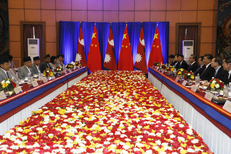 Chinese President Xi Jinping, third right and Nepalese Prime Minister Khadga Prasad Oli, left sit face to face during  a bilateral meeting in Kathmandu, Nepal, Sunday, Oct. 13, 2019. Xi on Saturday became the first Chinese president in more than two decades to visit Nepal, where he's expected to sign agreements on some infrastructure projects. (Bikash Dware/The Rising Nepal via AP)