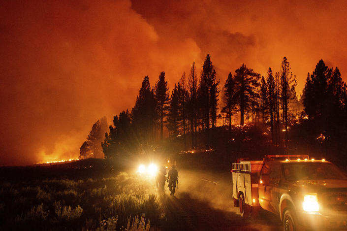 Firefighters battle the Sugar Fire, part of the Beckwourth Complex Fire, burning in Plumas National Forest, Calif., Thursday, July 8, 2021. (AP Photo/Noah Berger)
