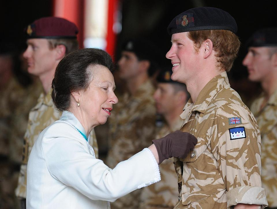 WINDSOR, UNITED KINGDOM - MAY 5: (NO PUBLICATION IN UK MEDIA FOR 28 DAYS) Princess Anne, Princess Royal presents Afghanistan war campaign medals to officers and soldiers of the Household Cavalry Regiment, including Lieutenant Wales, Prince Harry, at Combermere Barracks on May 5, 2008 in Windsor, England. (Photo by POOL/ Tim Graham Picture Library/Getty Images)