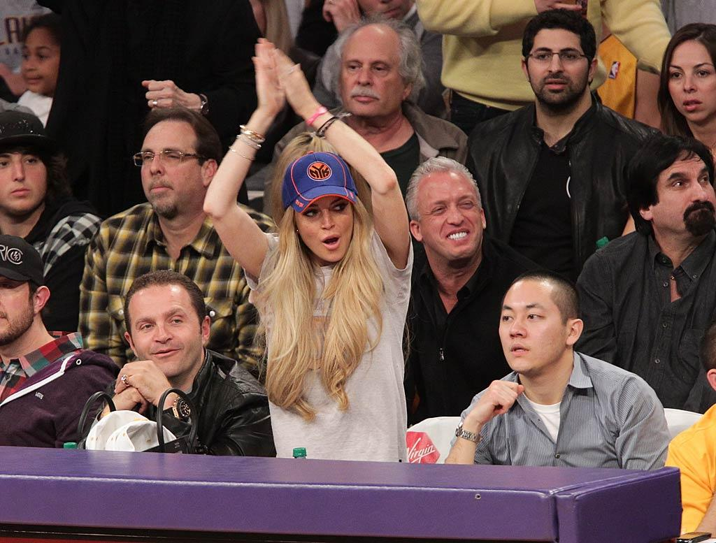 """Lindsay Lohan sported Knicks gear while attending Sunday night's Lakers game with jeweler Pascal Mouawad (left) at the Staples Center in downtown Los Angeles. """"Kobe sent me #lakers hats coz I'm wearing Knicks- I'm from NY!!! Gotta stay loyal!,"""" she tweeted. """"Good luck to BOTH teams! #onelove I said if lakers win, I'll come to a game w/a laker hat!"""" Noel Vasquez/<a href=""""http://www.gettyimages.com/"""" target=""""new"""">GettyImages.com</a> - January 9, 2011"""