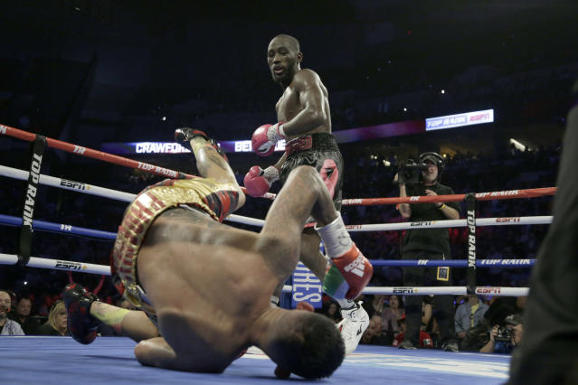Terence Crawford watches as Jose Benavidez goes down in the 12th round during their WBO welterweight title boxing bout in Omaha, Nebraska, Saturday, Oct. 13, 2018. (AP Photo/Nati Harnik)