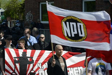 Supporters of the National Democratic Party of Germany (NPD) march during May Day demonstrations in Neumuenster in this May 1, 2012 file picture. REUTERS/Fabian Bimmer/Files